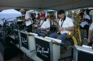 The Mobile Big Band Society performs in Cathedral Square during the Arts Alive festival in April. From left are Ron Smith, lead alto sax; Jeff Lynn, lead tenor sax; and Chief U.S. District Judge William Steele, alto sax. (Press-Register/Victor Calhoun)